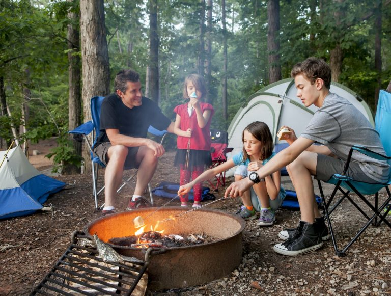 father camping with kids